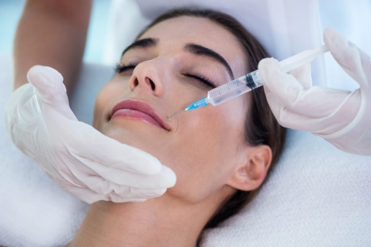Woman receiving botox injection at spa