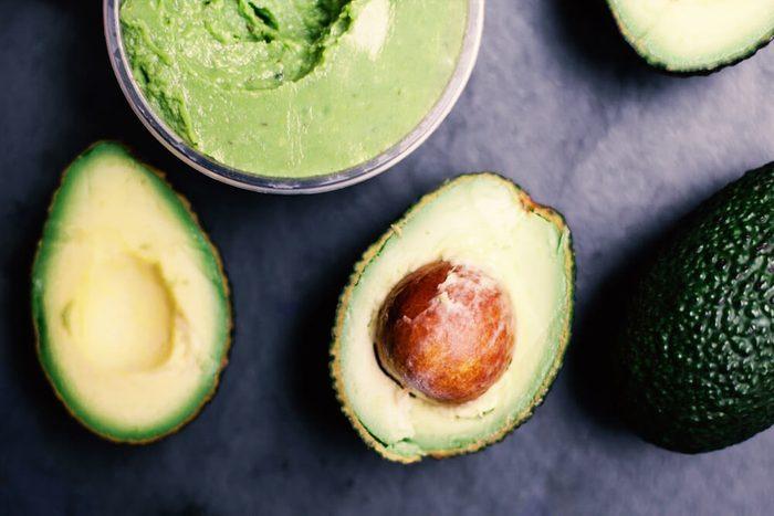 Halved avocados. Top view. spread. pasta. Guacamole