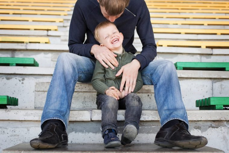 Father and son playing in empty stadium