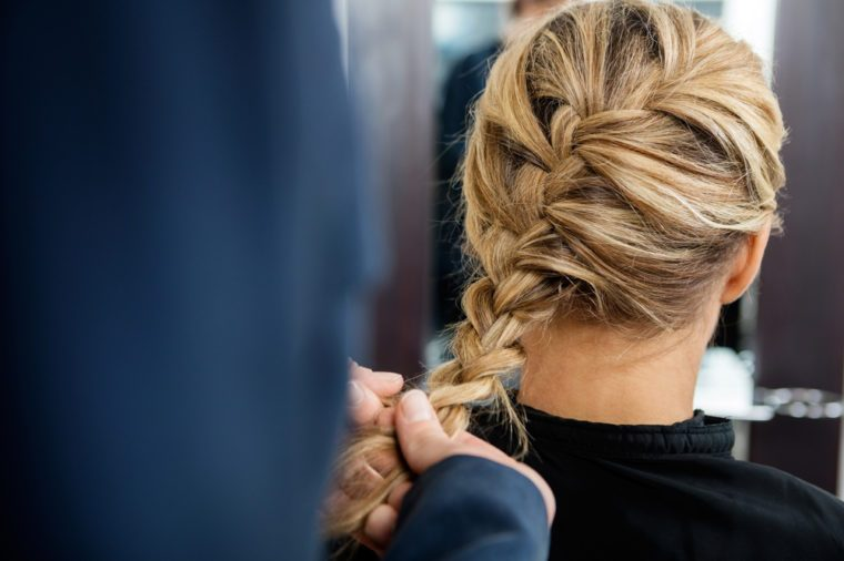 Cropped Image Of Hairdresser Braiding Client's Hair