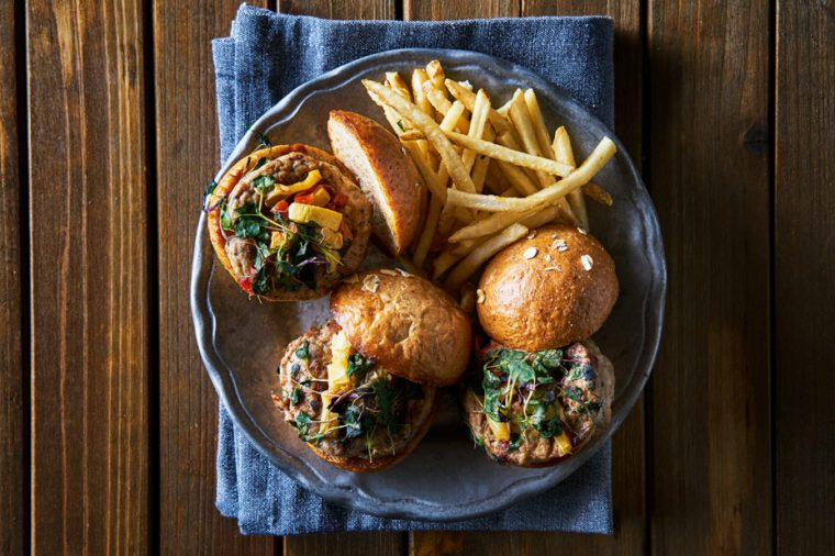 three turkey burger sliders with fries shot from over head in flat lay composition