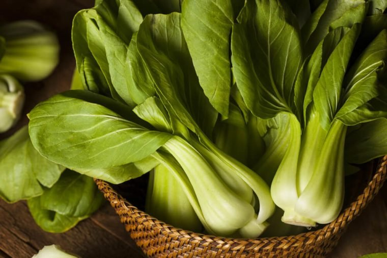 Raw Organic Baby Bok Choy on a Background