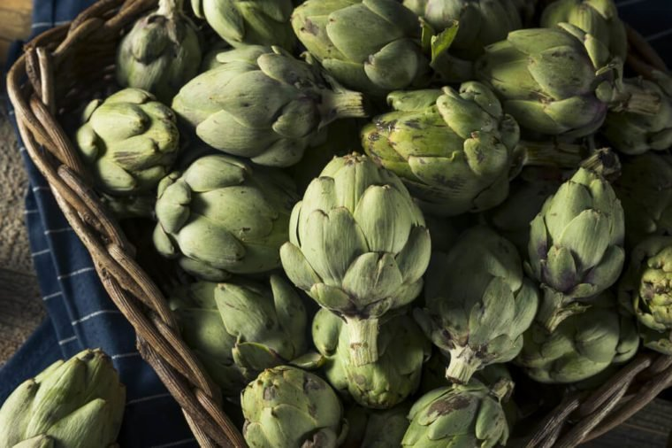 Healthy Raw Green Organic Baby Artichokes in a Basket
