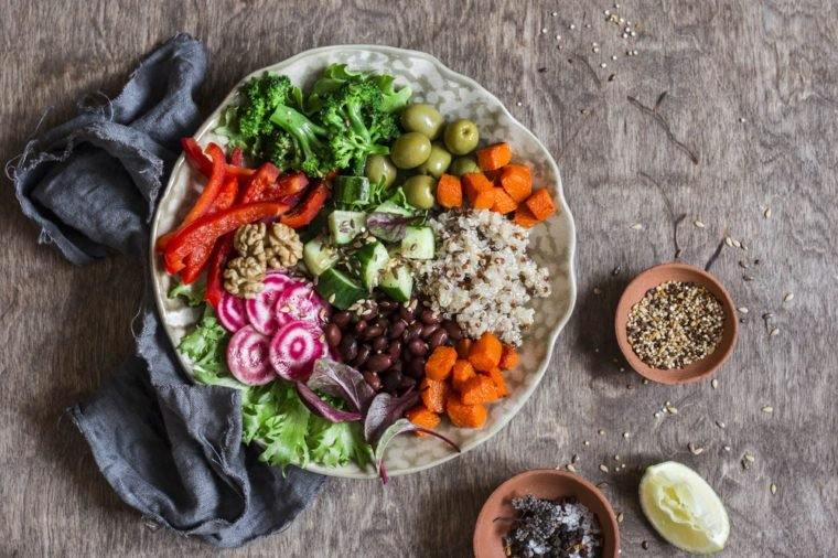 Vegetarian buddha bowl. Raw vegetables and quinoa in a one bowl. Vegetarian, healthy, detox food concept