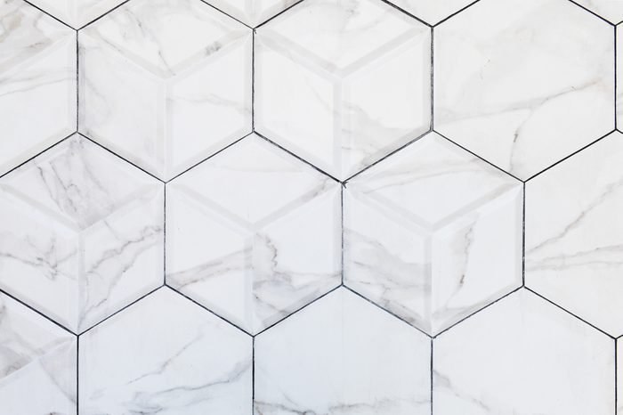 White hexagon marble tile wall for background , for Interiors design. High resolution