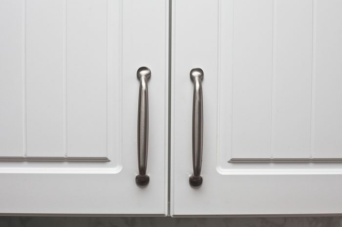 Chrome handles on a pair of wooden cupboard doors