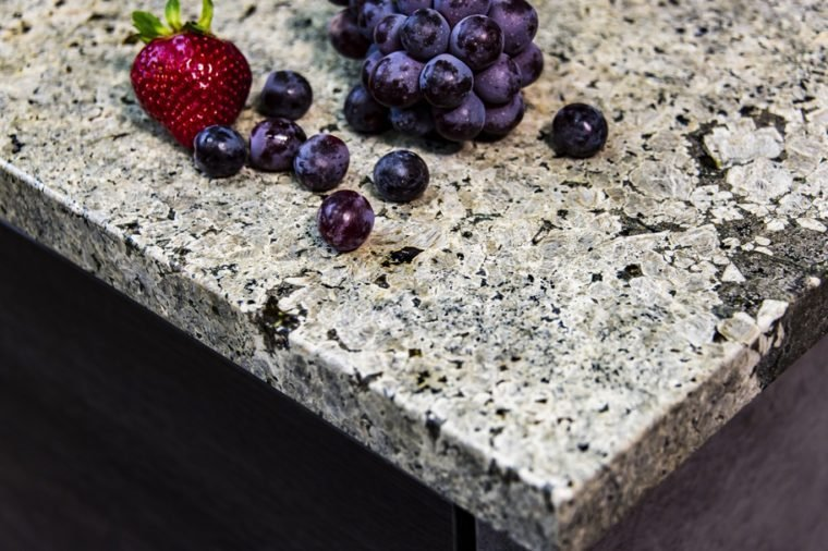 Granite kitchen counter top made of natural stone slab with fruits on it