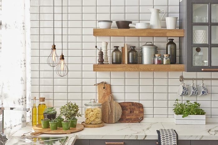 white tiles wall modern kitchen with chopping board, modern lamp