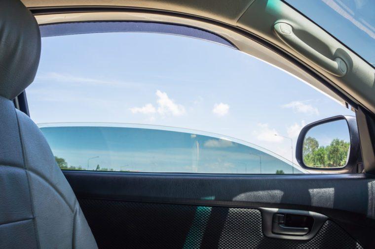 The door car open window glass with blue sky view.