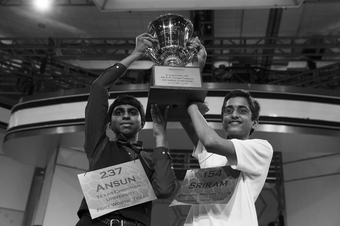 Ansun Sujoe, 13, of Fort Worth, Texas, left, and Sriram Hathwar, 14, of Painted Post, N.Y., raise the championship trophy after being named co-champions of the National Spelling Bee,, in Oxon Hill, Md