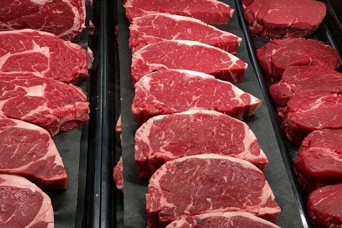 Strip steaks in a butcher's window