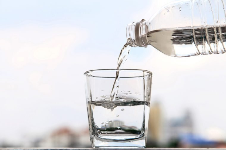 Glass of water and bottle