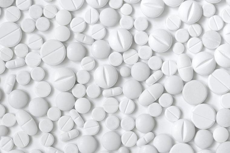 White pills, white background