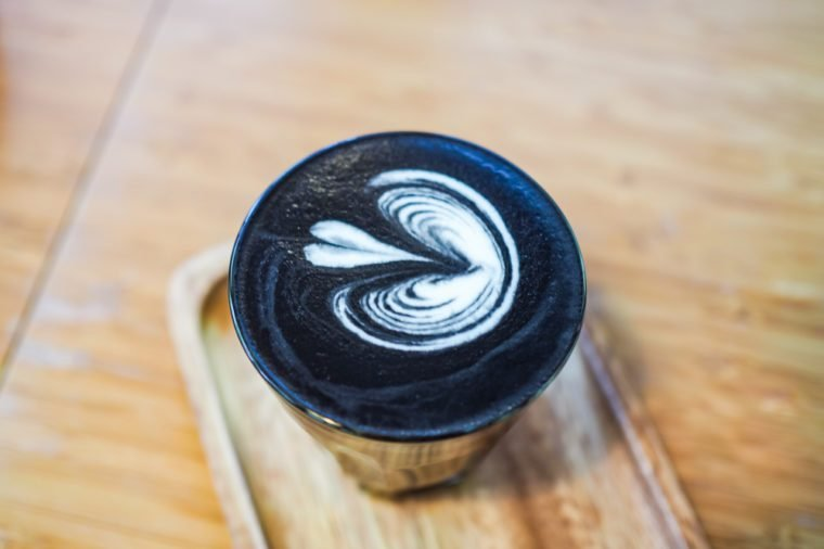 Charcoal coffee on wooden table