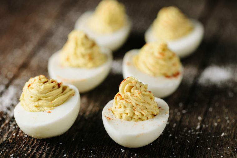 Homemade deviled eggs on wooden surface