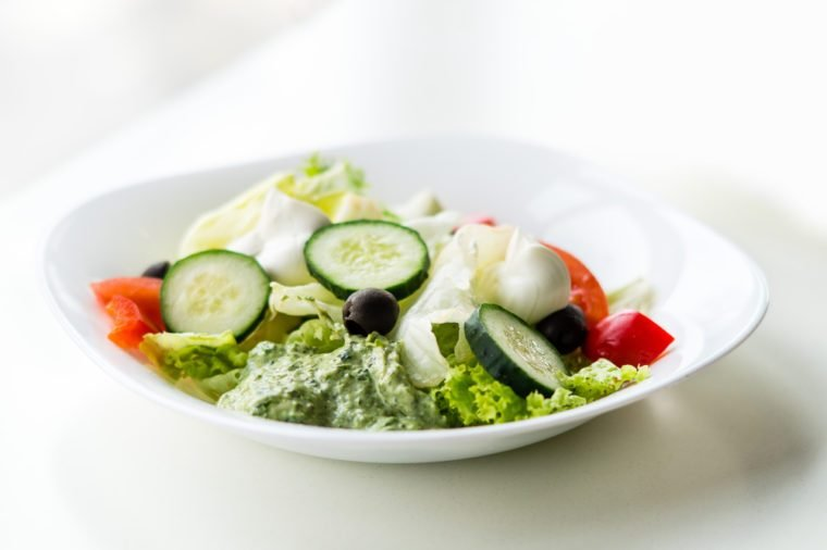 Greco salad with pesto sauce. Vegetable salad with Philadelphia cheese. Greek salad.