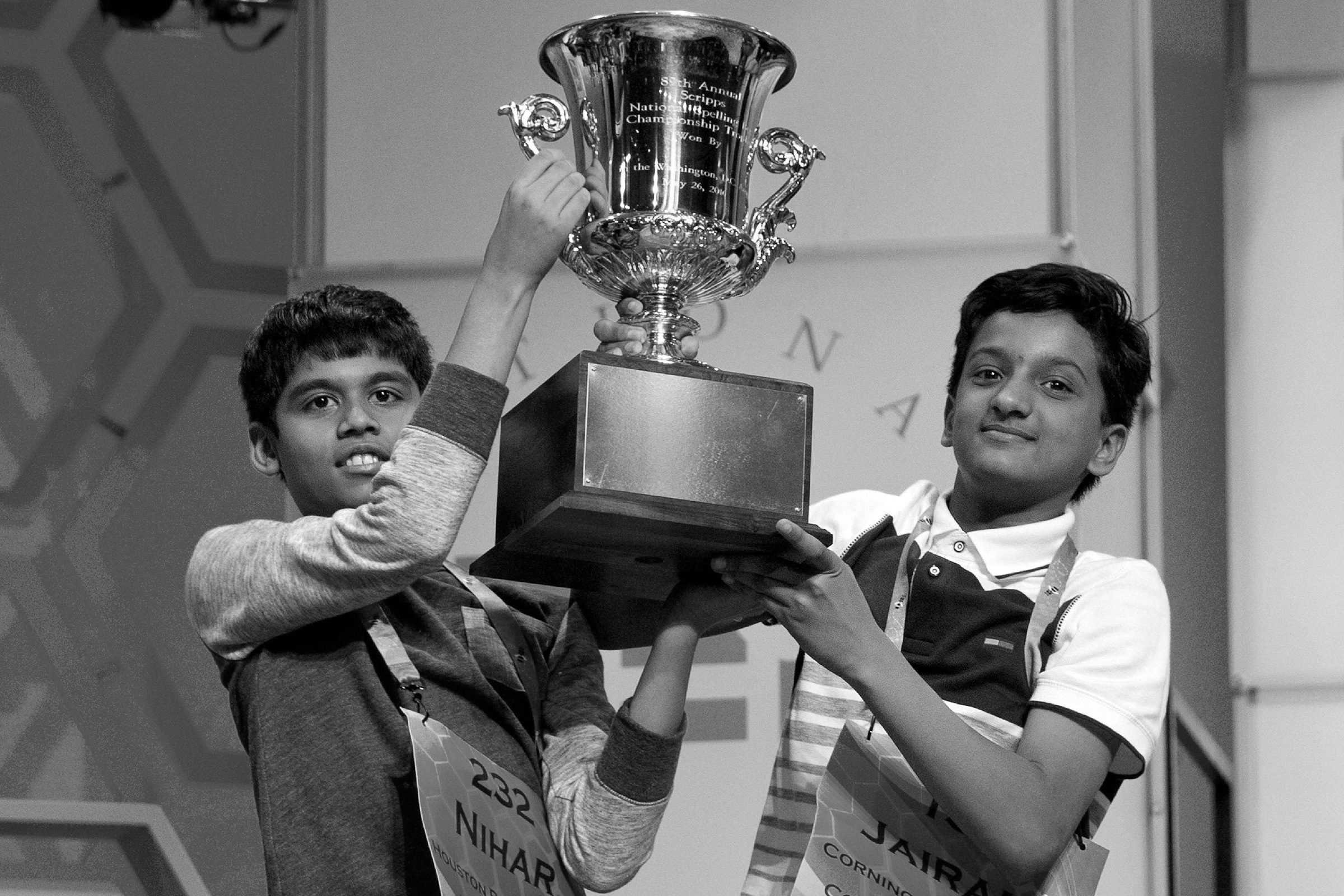 Jairam Hathwar, Nihar Janga Nihar Janga, 11, of Austin, Texas, and Jairam Hathwar, 13, of Painted Post, N.Y., hold up the trophy after being named co-champions at the 2016 National Spelling Bee, in National Harbor, Md., on