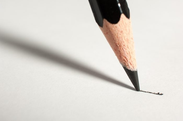 Close up of a pencil writing on paper.