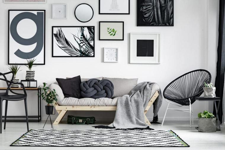 make living room spacious using simple and smart tricks how to get started in interior design Wooden sofa with dark pillows in scandi style living room