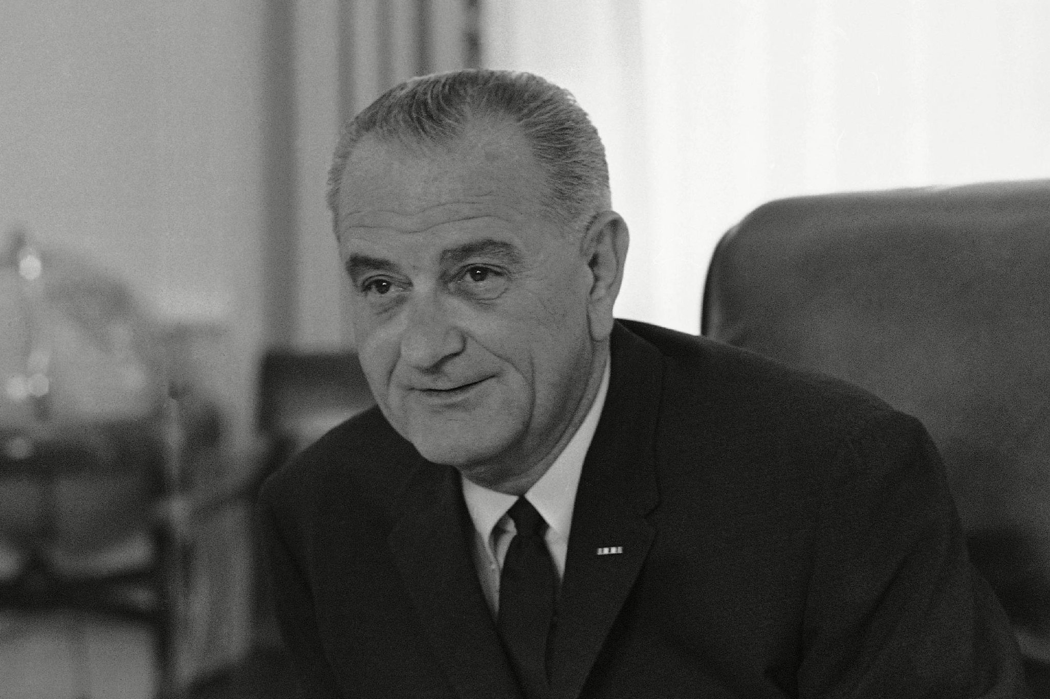 President Lyndon B. Johnson sits in his office in the White House