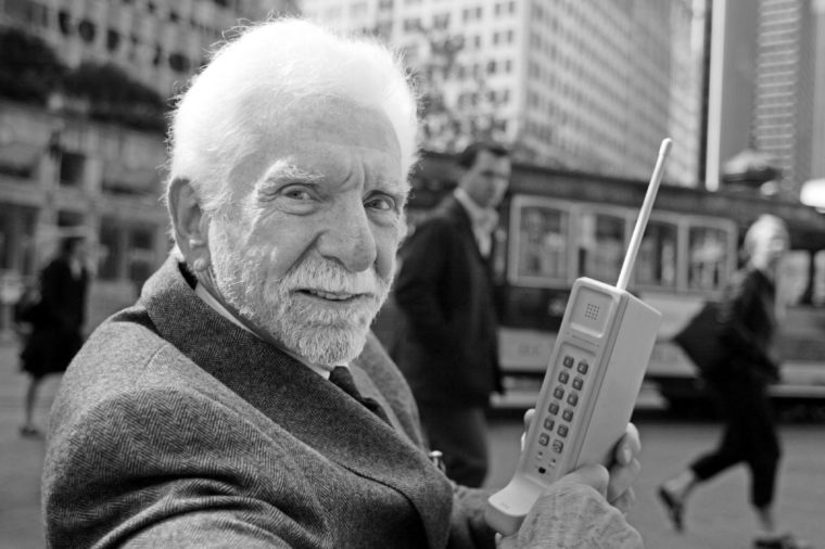 COOPER Martin Cooper, chairman and CEO of ArrayComm, holds a Motorola DynaTAC, a 1973 prototype of the first handheld cellular telephone on Market Street in San Francisco, . 30 years ago the first call was made from a handheld cellular telephone