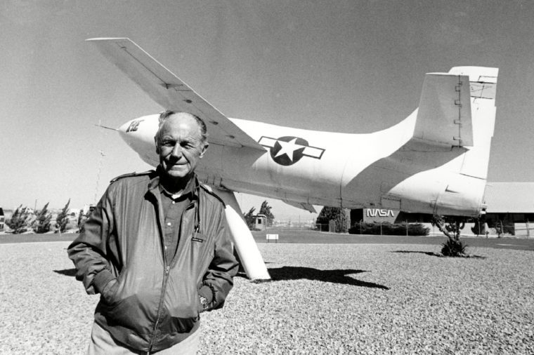 Yeager Chuck Yeager, the first pilot to break the sound barrier in 1947, poses in front of the rocket-powered Bell X-IE plane that he flew at Edwards Air Force Base on