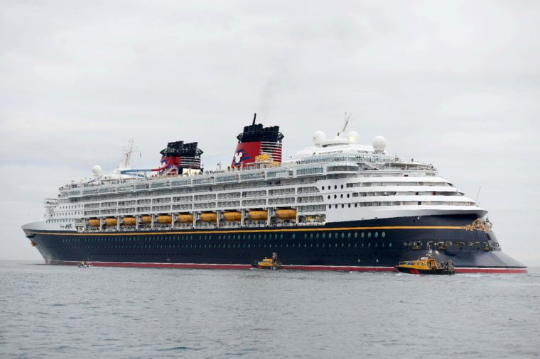Disney Magic cruise ship leaves Portland Port, Dorset, UK