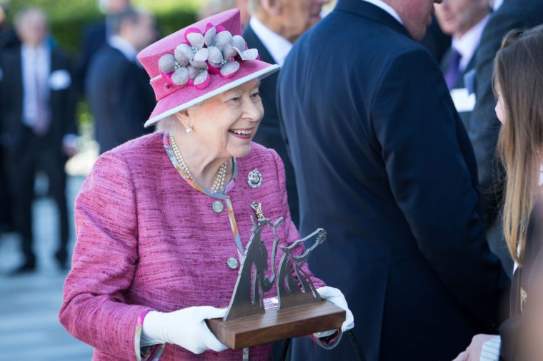 Queen Elizabeth II receives a Kelpies sculpture as a gift on a visit to the Kelpies to open the Queen Elizabeth II Canal at the Helix Park, Falkirk.
