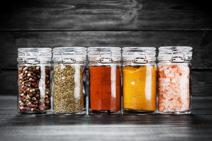 Set of different herbs and spice on dark background