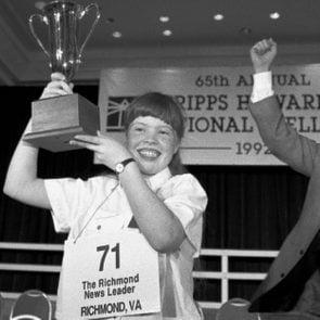 Amanda Goad, Dan Thomasson Amanda Goad, 13, of Richmond, Va., holds up her trophy after spelling