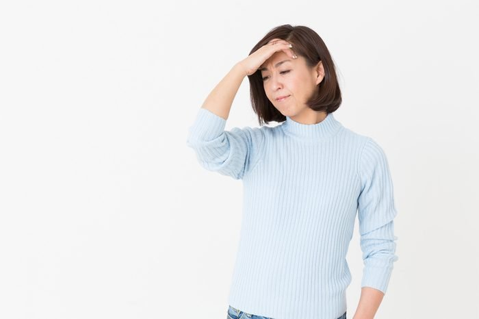 Asian middle age woman who gets tired