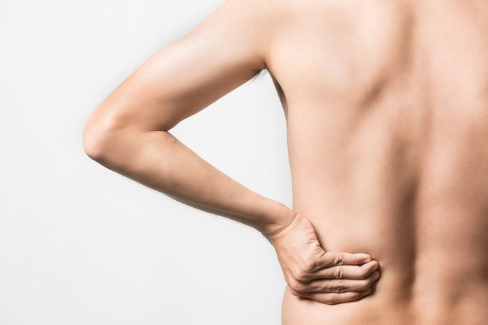 Closeup portrait of a man suffers from backache standing over white background, A man who has a shoulder pain.Concept with Healthcare And Medicine.