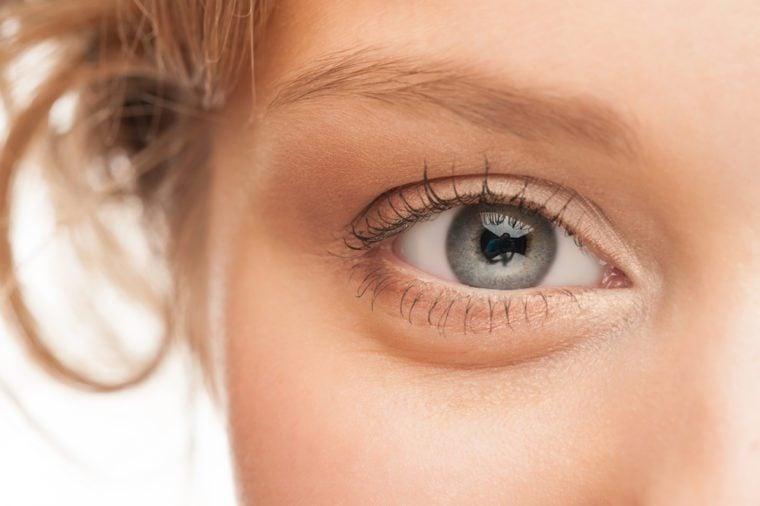 Close-up shot of woman eye with beautiful makeup looking at camera