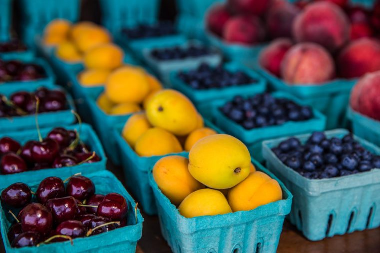Rows of various fruits in boxes at country roadside stand in rural Pennsylvania.