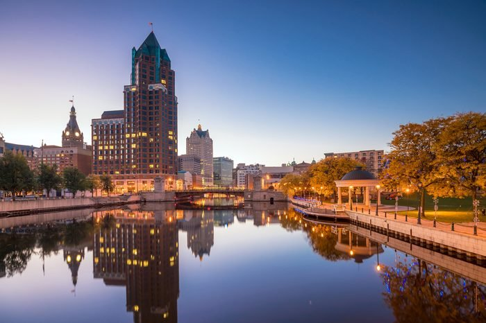 Downtown skyline with Buildings along the Milwaukee River at night, in Milwaukee, Wisconsin.