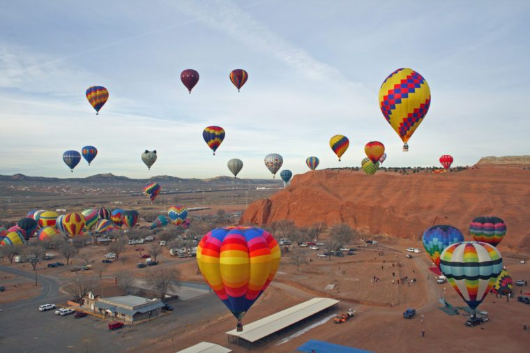 Mass hot air balloon ascension at the annual Red Rocks Balloon Festival at the Red Rocks State Park near Gallup, New Mexico.