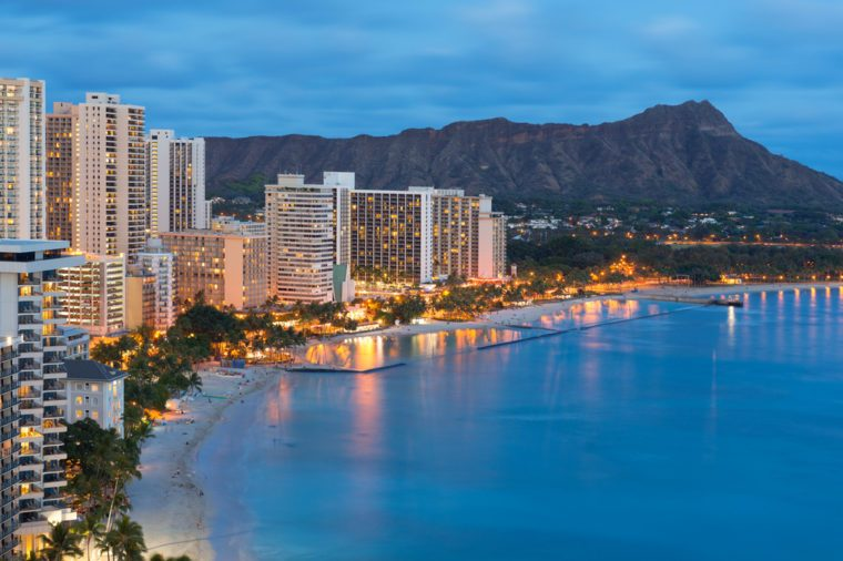 Scenic view of Honolulu city, Diamond Head and Waikiki Beach at night; Hawaii, USA
