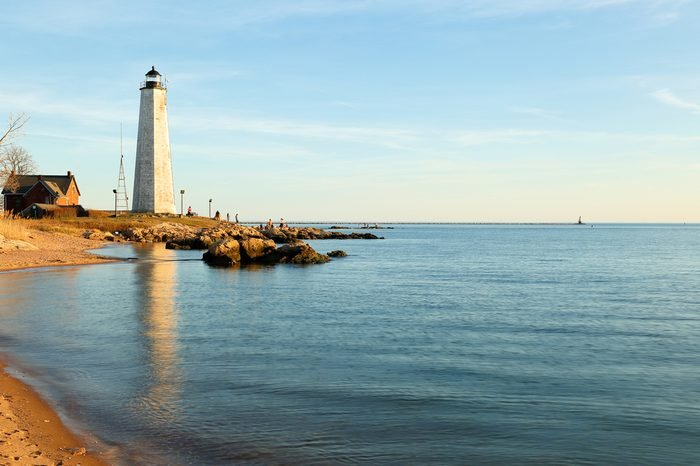 New Haven Light House at Lighthouse Point Park At Sunset. The lighthouse is dark, but the tower remains, greeting ships from around the world to New Haven.