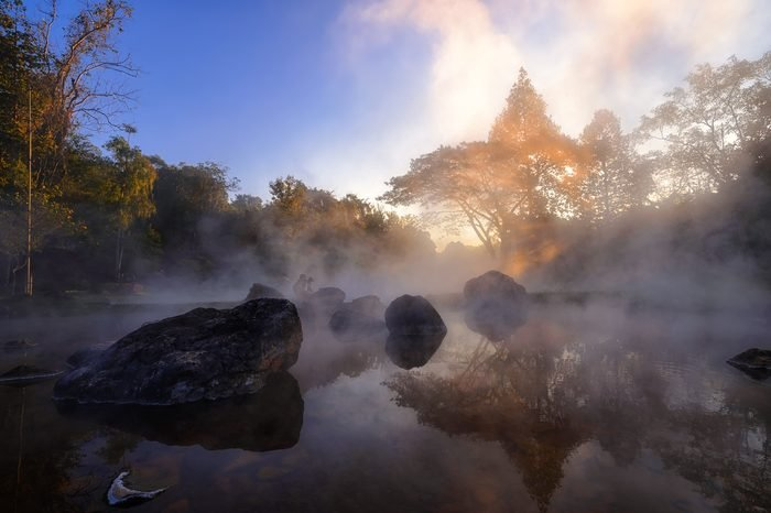 The hot spring with a 73 degree Celsius water spring over rocky terrain. heat from the hot spring providing a misty and picturesque scene which is particular beautiful in the morning at National Park
