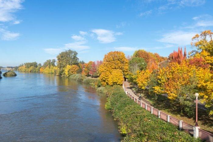 The Willamette River flows beside a bike path in Eugene, Oregon.