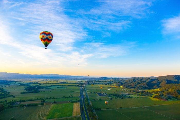 Hot Air Balloon Over Vineyards At Sunrise Over Napa Valley, Napa, California USA
