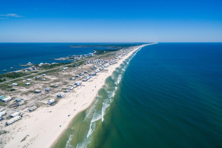 Drone/Aerial ocean photograph of the Gulf Shores/Fort Morgan peninsula. The warm Gulf of Mexico washes onto this pristine white sand beach. Alabama, USA