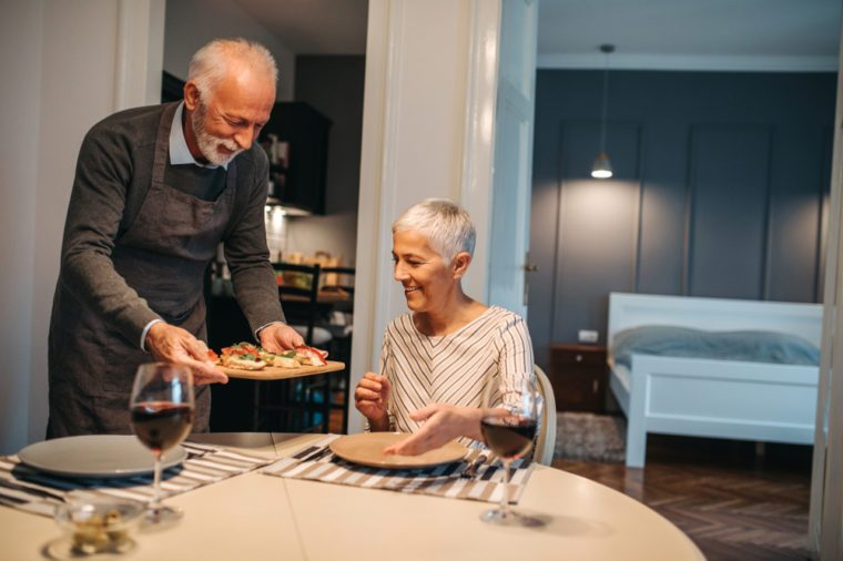 Elderly couple in the dining room about to enjoy their meal
