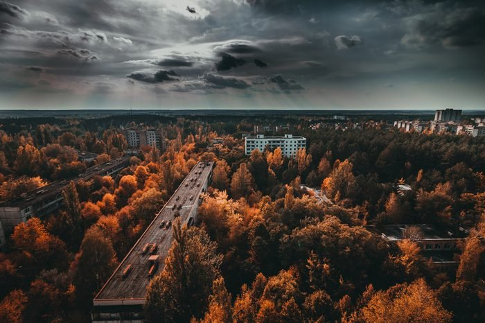 Chernobyl exclusion zone. Ruins of abandoned Pripyat city. Autumn in zone of exclusion. Zone of high radioactivity. Panoramic view of ghost town. Ruins of buildings. Chernobyl. Ukraine.