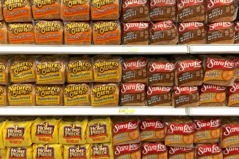 Alameda, CA - July 21, 2017: Grocery store shelf with many loaves of bread. Home Pride wheat, Nature's Won butter bread and honey wheat, Sara Lee Whole Wheat and honey wheat.