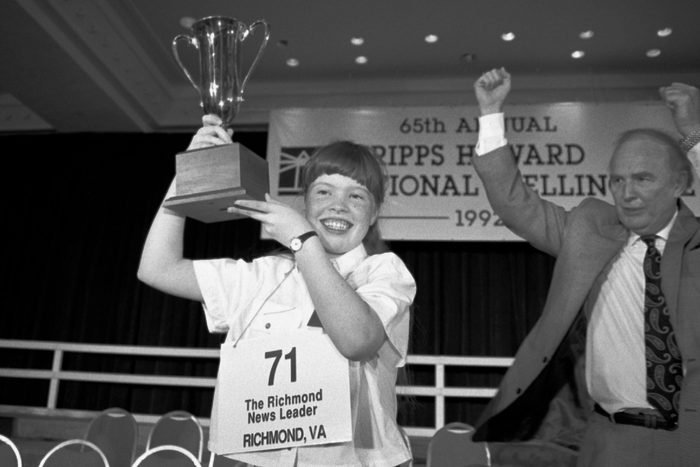 """Amanda Goad, Dan Thomasson Amanda Goad, 13, of Richmond, Va., holds up her trophy after spelling """"lyceum"""" correctly to win the 65th annual National Spelling Bee in Washington, D.C., . Dan Thomasson, vice president of Scripps-Howard celebrates at right"""