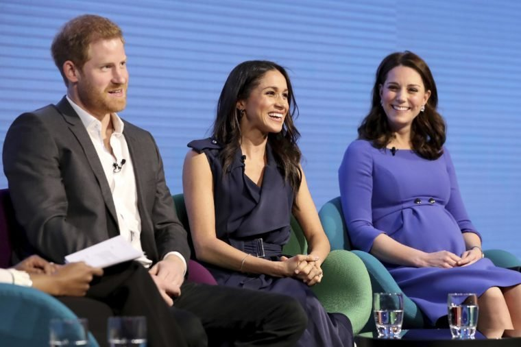 Britain's Kate, Duchess of Cambridge, right, with Prince Harry and his fiancee Meghan Markle attend the first annual Royal Foundation Forum in London, . Under the theme 'Making a Difference Together', the event will showcase the programmes run or initiated by The Royal Foundation