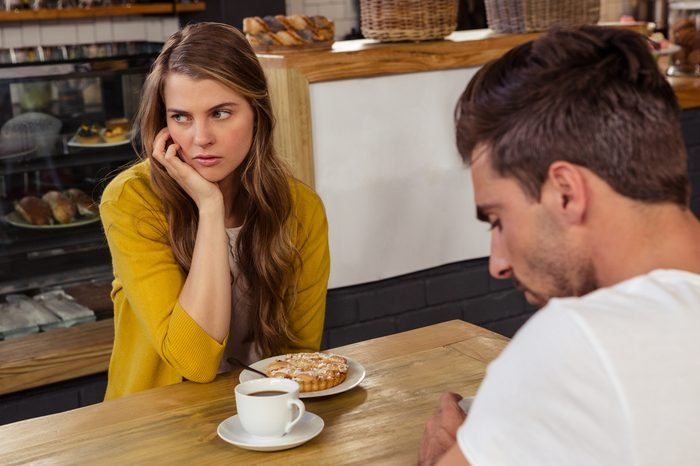 Couple sitting and tension feeling in the restaurant