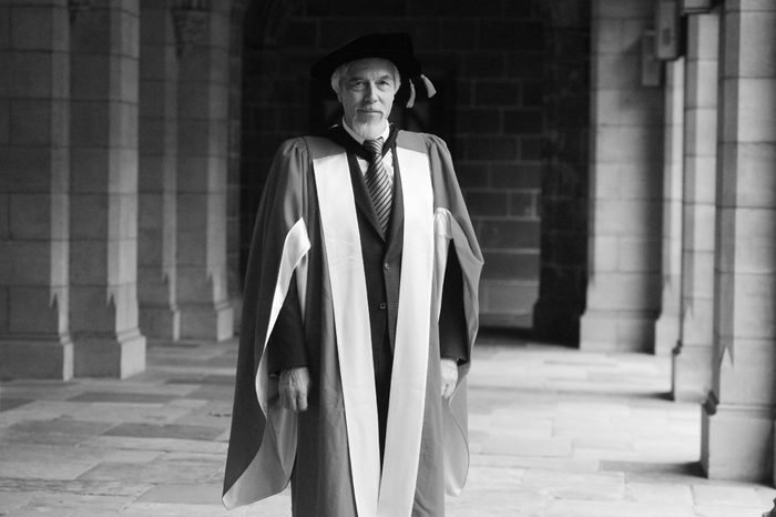 Director-general of Cern Professor Rolf Dieter Heuer Poses For a Photo After He was Awarded a Doctor of Laws (honoris Causa) at Melbourne University in Melbourne 06 July 2012 Professor Heuer is One of the Key Scientists Involved in the Discovery of the Higgs Boson Also Referred to As the 'God Particle' Australia Melbourne