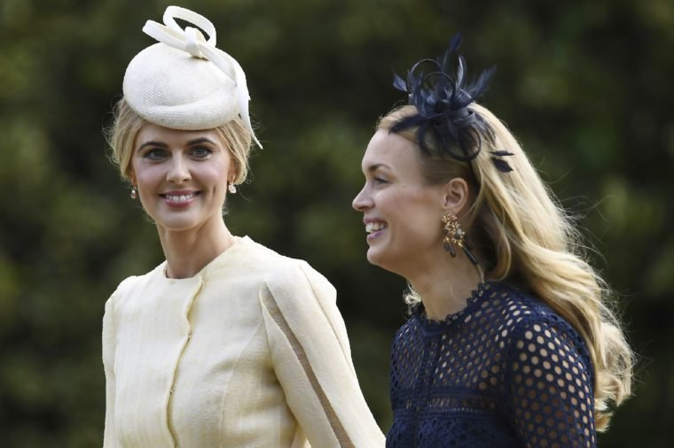 Donna Air, left, arrives at St Mark's Church in Englefield, England, ahead of the wedding of Pippa Middleton and James Matthews, . Middleton, the sister of Kate, Duchess of Cambridge is to marry hedge fund manager James Matthews in a ceremony Saturday where her niece and nephew Prince George and Princess Charlotte are in the wedding party, along with sister Kate and princes Harry and William